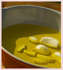 Cloves in mustard oil for massage in cold